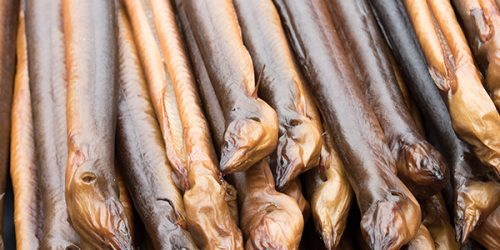 A dutch traditional snack smoked fish prepared in the smoke oven and ready to eat